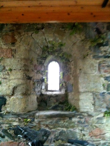 Inside of Ronan's Chapel where lots of grave slabs are stored