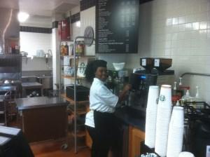 Mina Thompson prepares coffee at the new SAIS DC cafe. (Tristram Thomas)