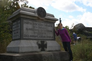 Anne Gillman, second-year Southeast Asia M.A. student, poses at the statue of her great great great grandfather David Morgan's 146th New York Volunteer Infantry regiment, which fought at Little Round Top during the Battle of Gettysburg. (Jameel Khan)