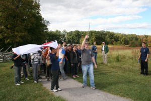 """SAIS second-year Strategic Studies students and Quartermasters of the Gettysburg Campaign Fall Staff Ride, Nate Rozelle and Mike Youn, lead the march and Confederate advance better known as """"Pickett's Charge"""". (Jameel Khan)"""