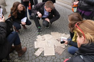 Students inspect a monument of papers in honor of the Weisse Rose (White Rose) group during WW2. (Alix Davie)