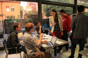 SAIS Europe students browse the 28 different clubs represented at the Club Fair, Thursday night (Oct. 23). (Photo by Grace West)