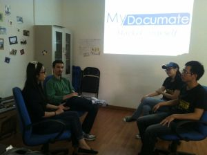 The authors (left) speak with MyDocumate's founders.