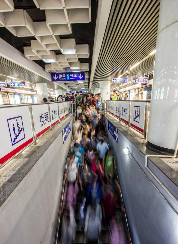 A waterfall of tourists pack the Nanjing metro.
