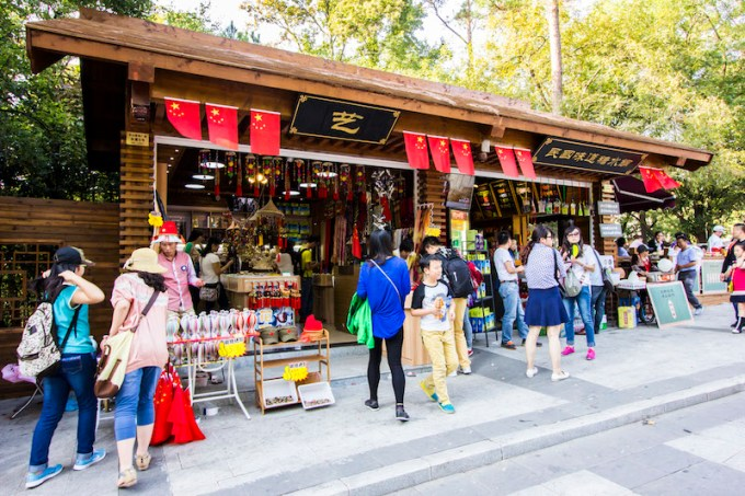 Stores near Sun Yat-Sen's mausoleum sell flags and other patriotic goods to tourists coming to climb the memorial staircase.