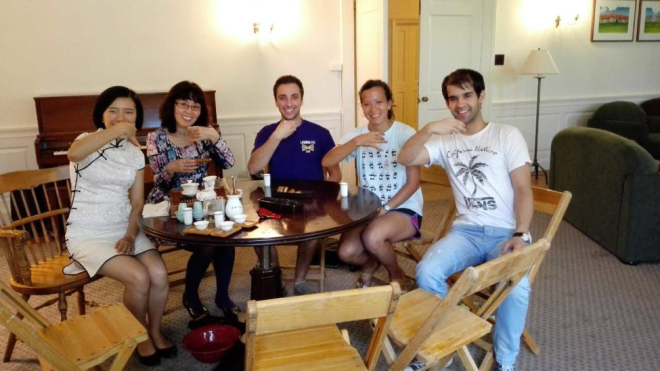 Certificate student Matt Geraci (center) enjoys a tea ceremony with professors and classmates at Middlebury's Mandarin summer immersion program in Vermont.