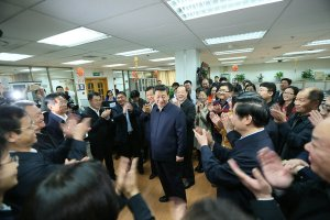 President Xi Jinping surrounded by supporters (photo courtesy of Wikimedia Commons)