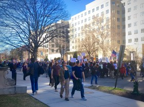 Classes were in session at Johns Hopkins, but that did not stop some students from cheering on protesters as they marched passed the SAIS D.C. campus on Massachusetts Avenue. (Photo Courtesy: Fatima Nanavati)
