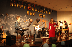 The Leeches play in front of the Halloween backdrop - Photo credits: Hopkins-Nanjing Center WeChat group
