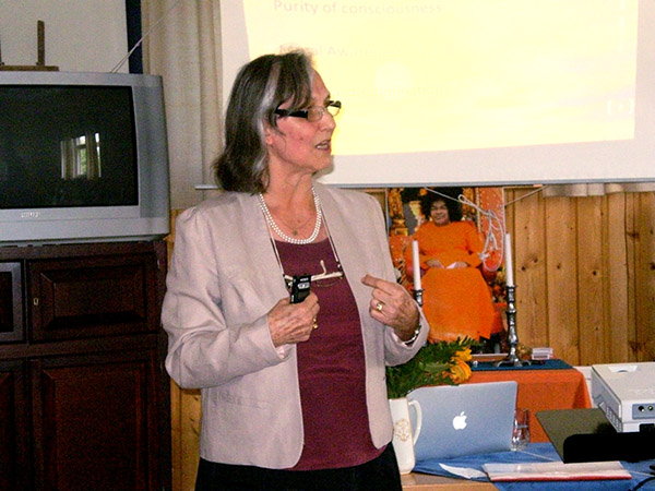Ms. Marianne Meyer speaks at the conference about spiritual excellence