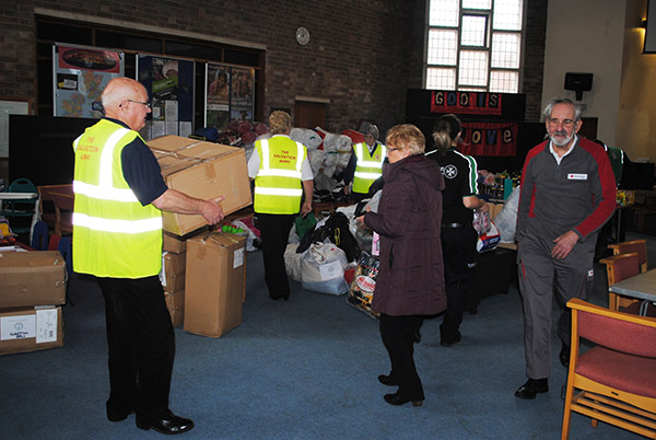 Volunteers collected essential goods at Sathya Sai Relief Hubs