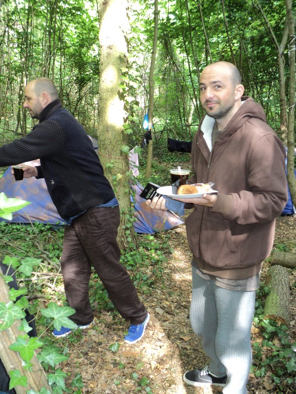 Serving food to the needy in a forest