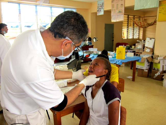 Fiji - Patient being examined at medical camp