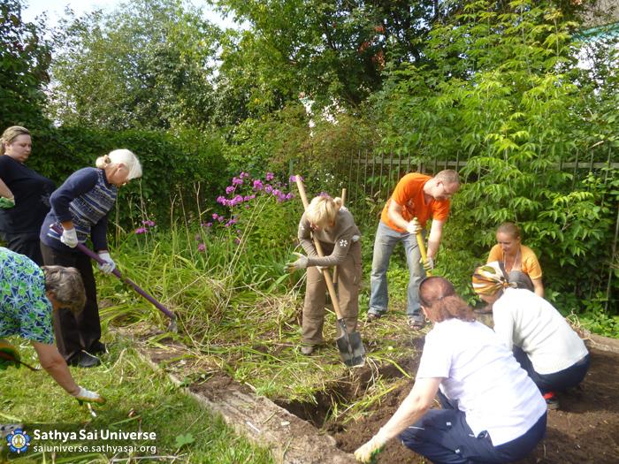 Volunteers planting flowers and bushes