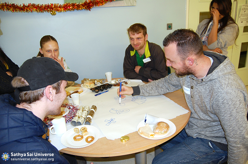 Volunteers celebrating Christmas with the homeless
