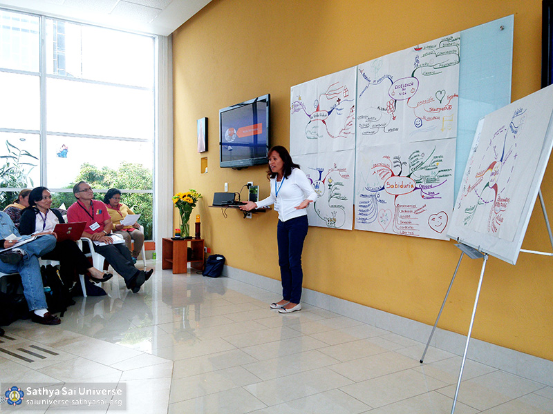 ssihve-facilitators-seminar-the-representative-of-one-of-the-groups-showing-their-conclusions-to-the-audience-sathya-sai-institute-of-human-values-bogota-colombia-zone-2b-feb-28-2016