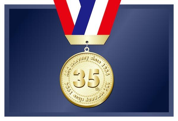 金メダルと三色リボン