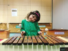 Playing for us in music class