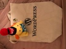 Wapuu and shopping bag