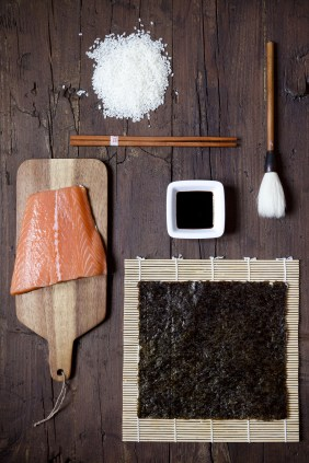 ingredients for sushi on wooden table