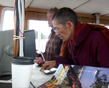 Khenpo Pema Wangdak on John Soderberg's boat on an outing to Jones Island