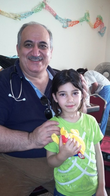 Our mission team leader with a visitor to the clinic