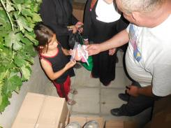 One of the children getting a hygiene kit