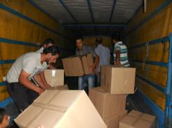 The boxes with the food packages being unloaded from the grocer's truck