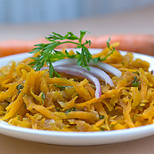 Warm Shredded Carrot Salad with Carrot Greens