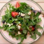 baby arugula, berries and macadamia nuts with strawberry ginger dressing