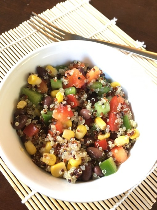 Corn & Black Bean Quinoa Salad - This delicious and nutritious salad can be eaten alone, as a side dish, in a wrap or in a salad with lettuce. Add chicken for some extra protein, avocado for some healthy fats or enjoy as is!
