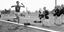 In a whirlwind finish, Louis Zamperini of the University of Southern California made his first appearance in the IC4A Championships in New York on May 27, 1939 and set a new meet record for the mile a minutes, 11.2 seconds. Here's Zamperini at the finish 20 yards ahead of Curtis Giddings of NYU, second. (AP Photo)