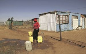 A resident makes use of a public water point in Boiketlong informal settlement in Sebokeng, south of Johannesburg. Picture: THE TIMES