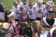 LAX Coach Maggi Pace gives last minute instructions to the squad