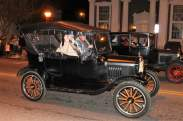 Antique car in the nighttime parade.