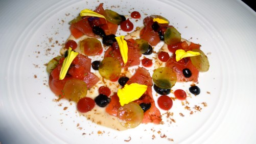 Ahi Tuna Crudo with Grapes, Pickled Plums, Black Olive, and Tonnato Sauce.