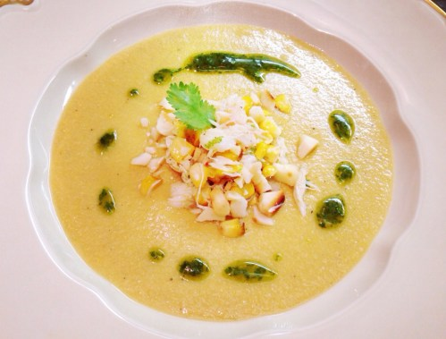 Corn and Coconut Soup with Crab, Thai Red Chili, and Macadamia Nut Relish, and Cilantro Oil.
