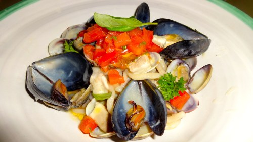 Homemade Bigoli with Clams, Mussels, and White Fish with Tomatoes (7/10).