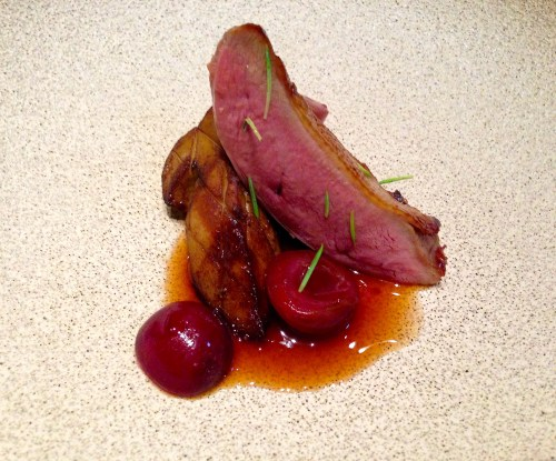 Squab with Porcini Mushroom, Bing Cherries, and Spruce Tips.