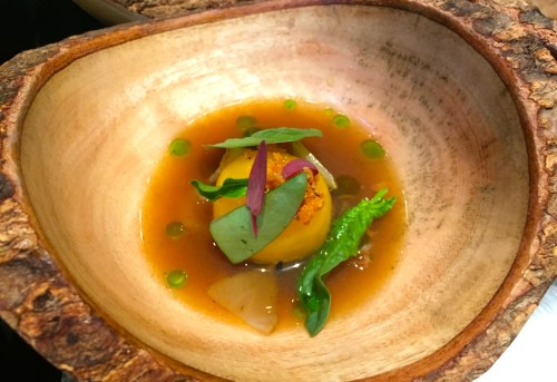 Egg Yolk Fudge with Broth, Pickled Green Strawberries, and Spinach.