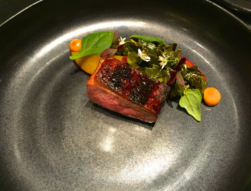 Grilled Duck with Braised Collard Greens and Pickled Pluots.