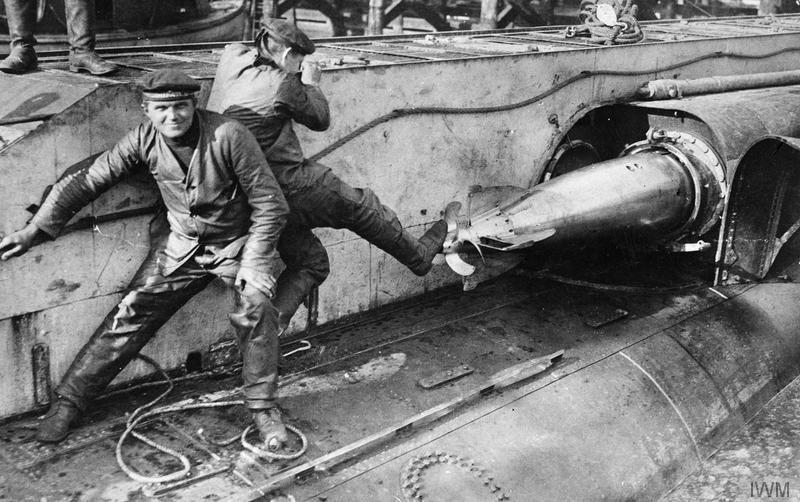 German Marines load torpedoes on their U-Boat © IWM