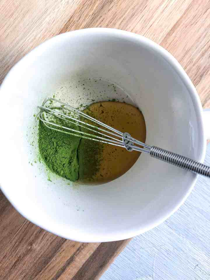 A bowl with matcha and honey.