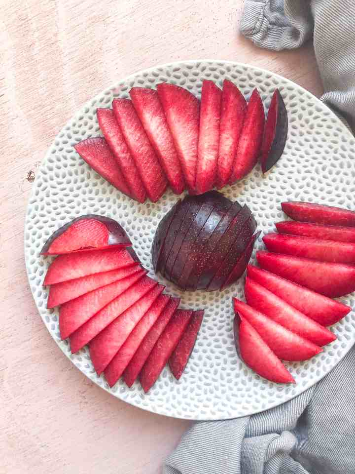 Freshly sliced plums on a plate.