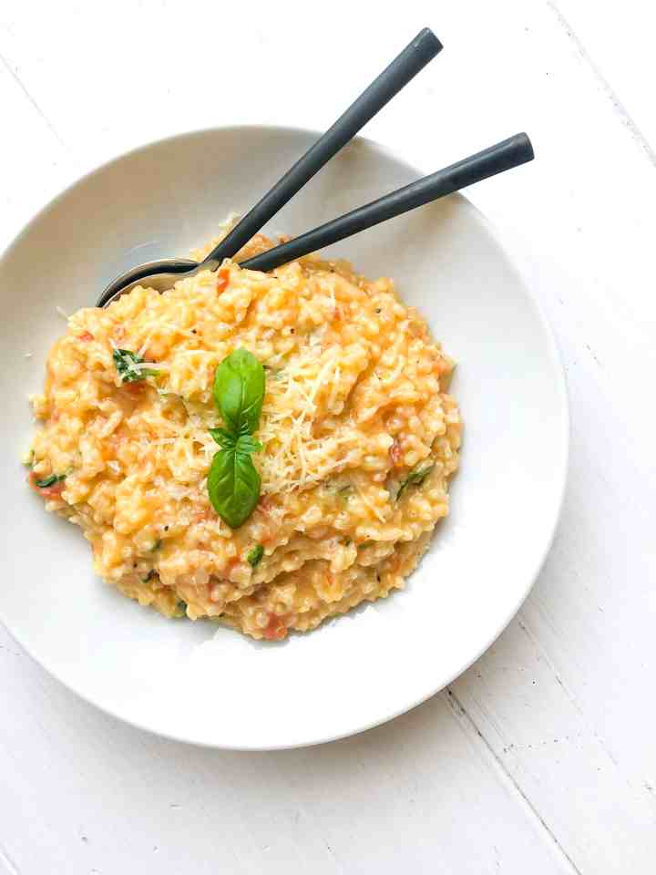 A bowl of fresh tomato basil risotto.