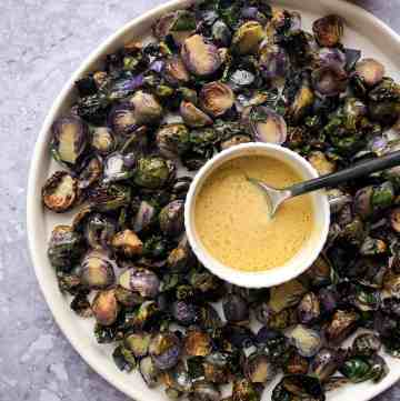 Lemon dijon brussels sprouts with a sauce.