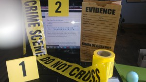 image with crime scene tape and evidence markers