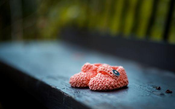 Photo by ?? Janko Ferli? on Unsplash pink baby shoes