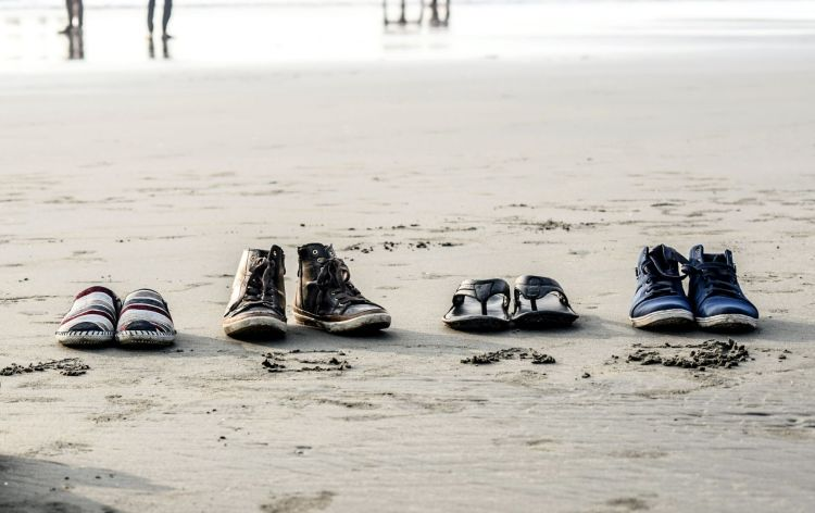 Photo by Md. Zahid Hasan Joy on Unsplash shoes lined up on a beach