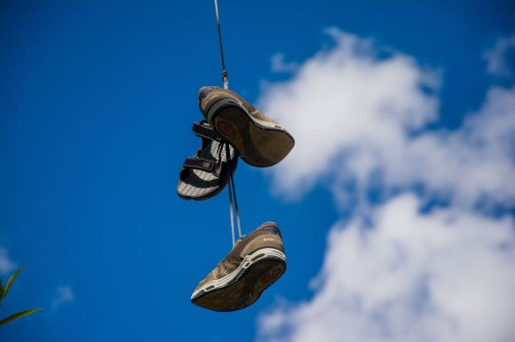 Photo by Tom Rogers on Unsplash shoes on a wire